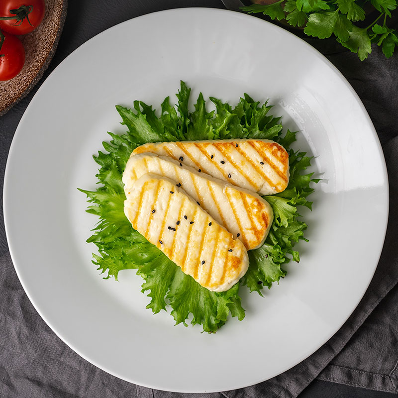 Halloumi cheese on plate | Featured image for cheese wholesaler.